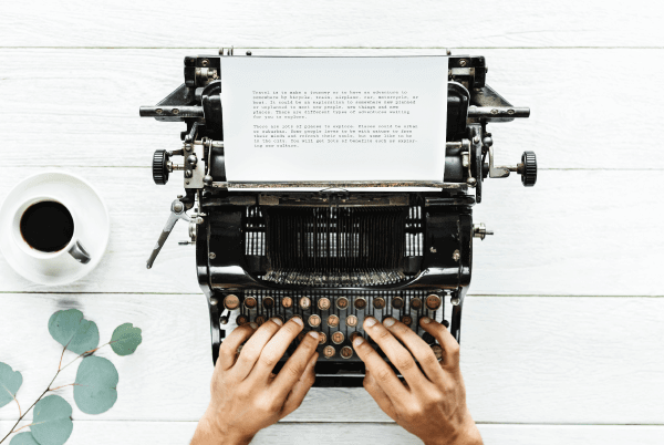 social media storytelling man writing on typewriter