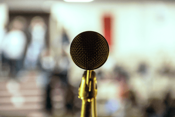 top social media influencers list - a microphone on a blurry screen