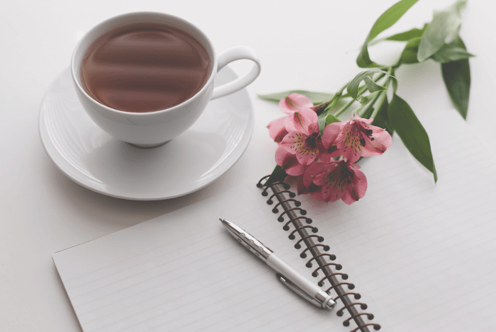 story brand pen notebook coffee flower